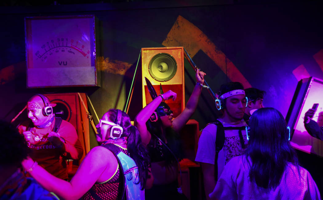 Attendees dance at a silent disco dance room during the first day of the Electric Daisy Carniva ...