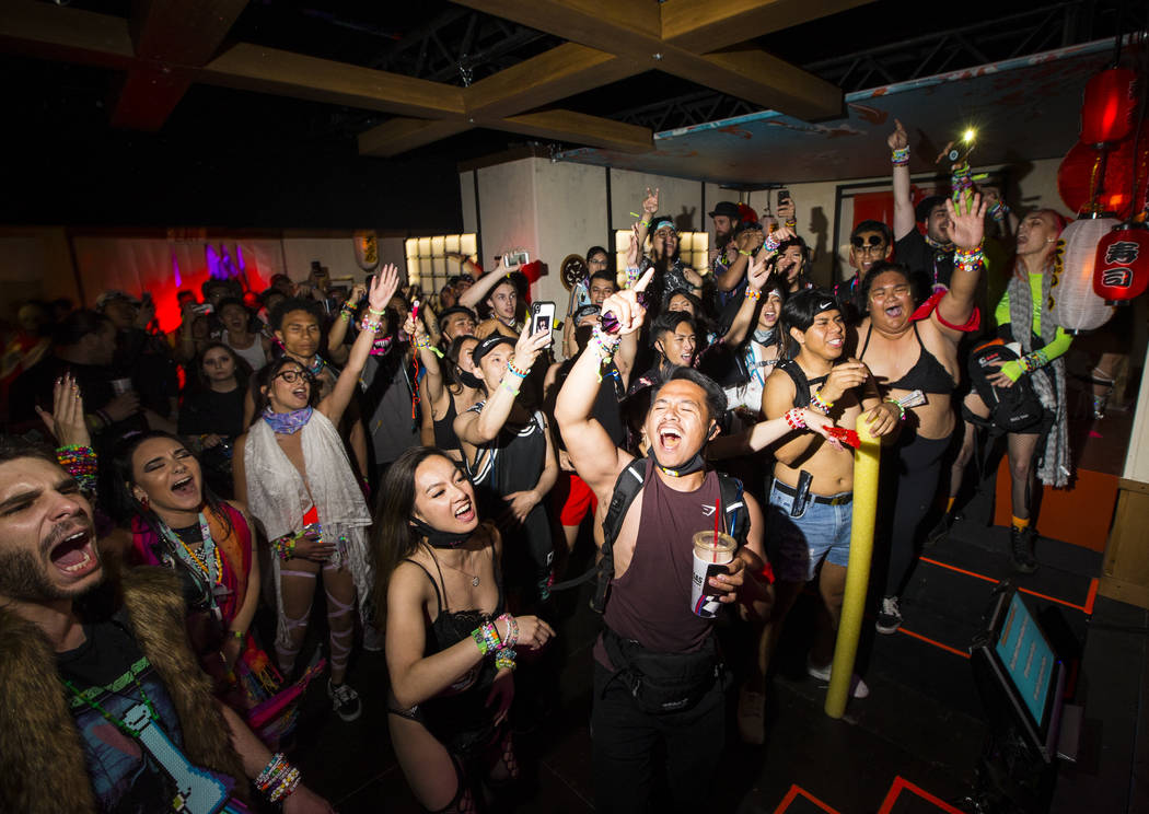 Attendees cheer on performers at the karaoke bar at the Downtown EDC area during the first day ...