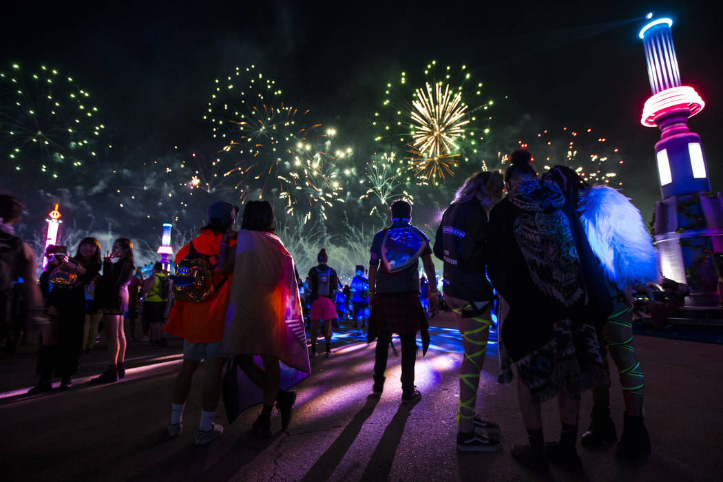 Attendees watch fireworks go off during the first day of the Electric Daisy Carnival at the Las ...