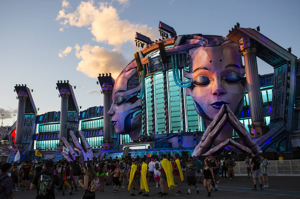 Attendees stand by the Kinetic Field stage during the first day of the Electric Daisy Carnival ...