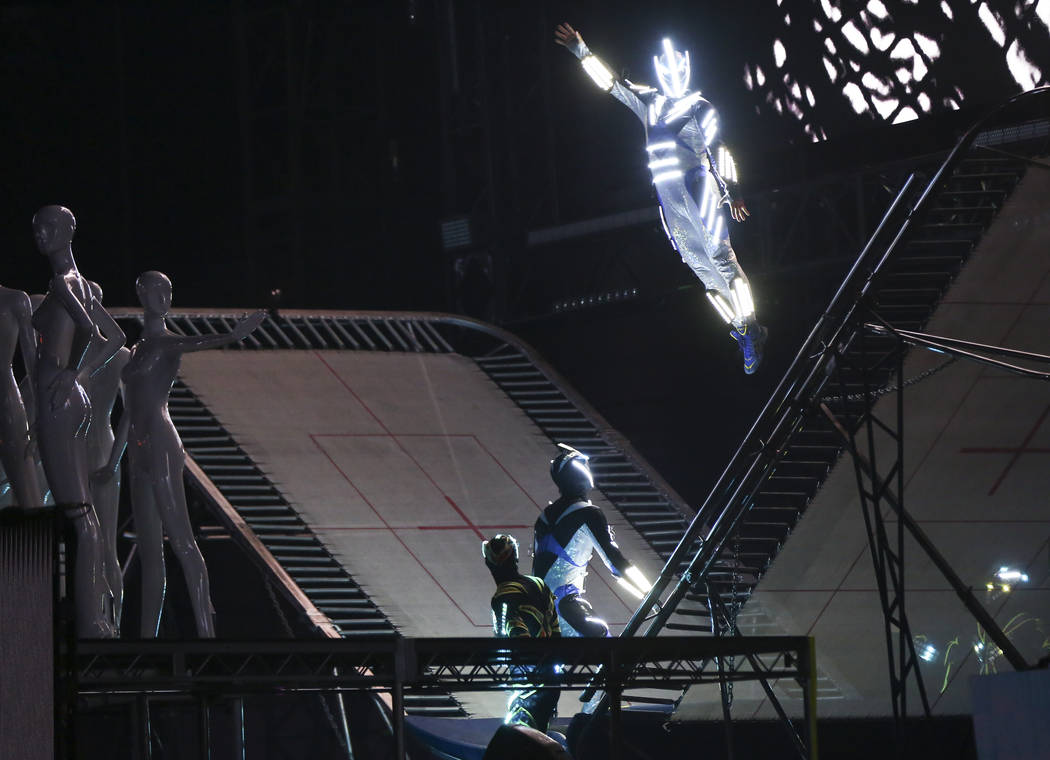 Performers wearing lit-up suits perform aerial stunts during the first day of the Electric Dais ...