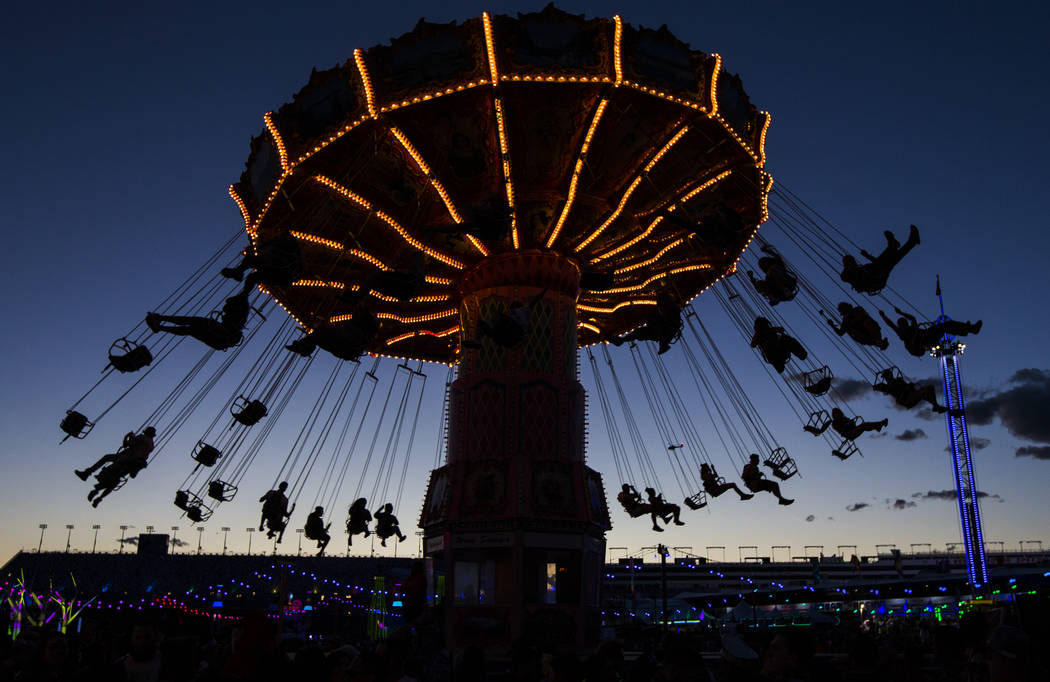 Attendees on a carnival ride during the first day of the Electric Daisy Carnival at the Las Veg ...