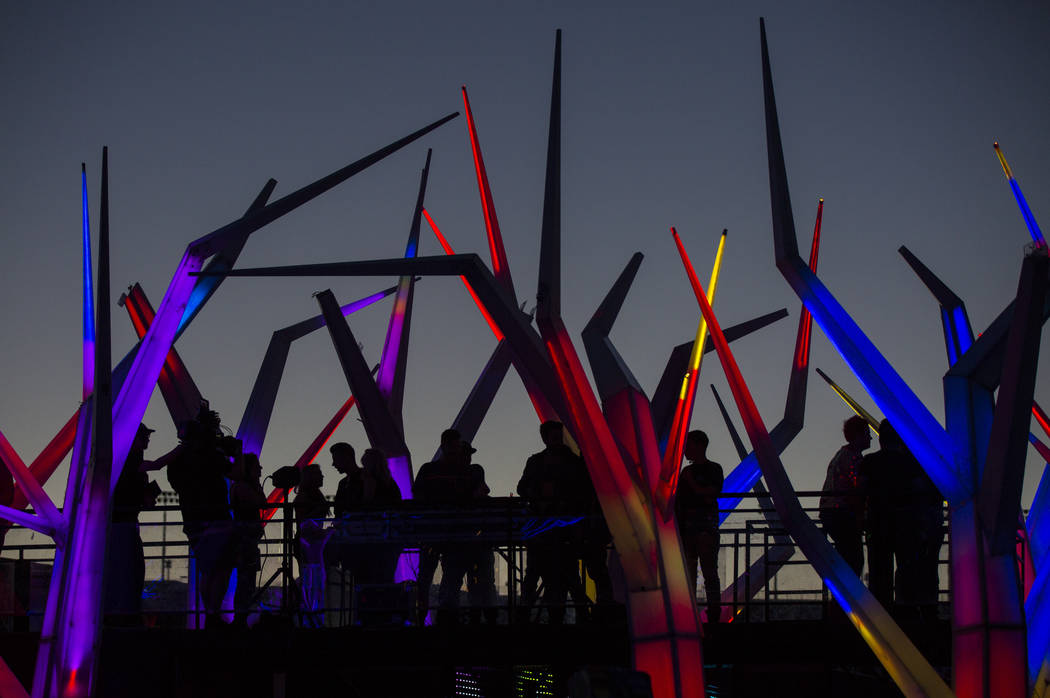 Attendees are silhouetted on top of the Forest House Art Car during the first day of the Electr ...