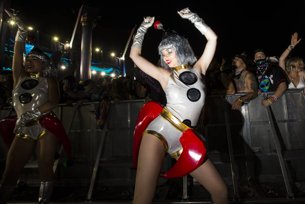Costumed performers entertain attendees as Excision performs at the Kinetic Field stage during ...