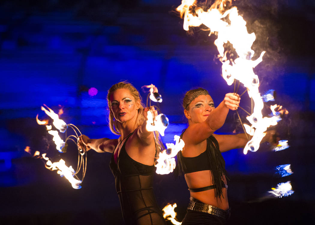Members of Springfield Aerial Fitness perform with fire during the first day of the Electric Da ...