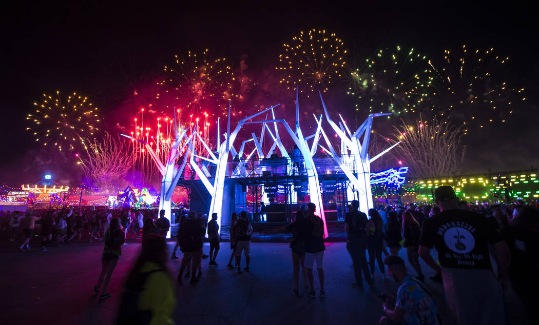 Fireworks go off above the Forest House art car during the first day of the Electric Daisy Carn ...