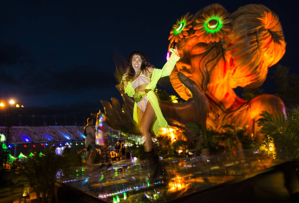Sofia Alengoz, of Las Vegas, dances by the Anima installation during the second day of the Elec ...