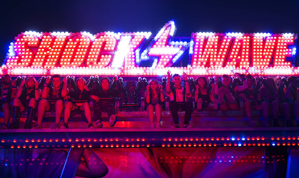 Concert goers ride the Shock Wave during day two of Electric Daisy Carnival at Las Vegas Motor ...
