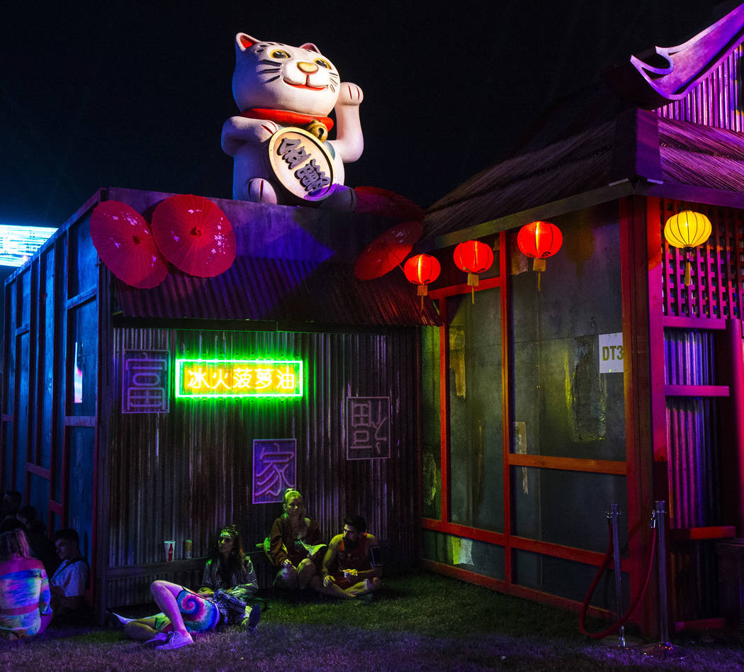Attendees relax by the Tokyo Karaoke Bar during the second day of the Electric Daisy Carnival a ...
