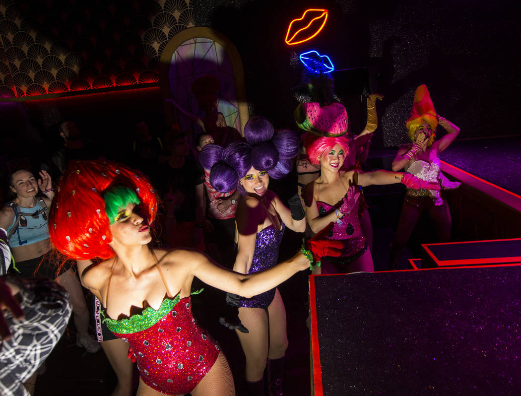 Costumed performers dance at The Queen in Downtown EDC at during the second day of the Electric ...