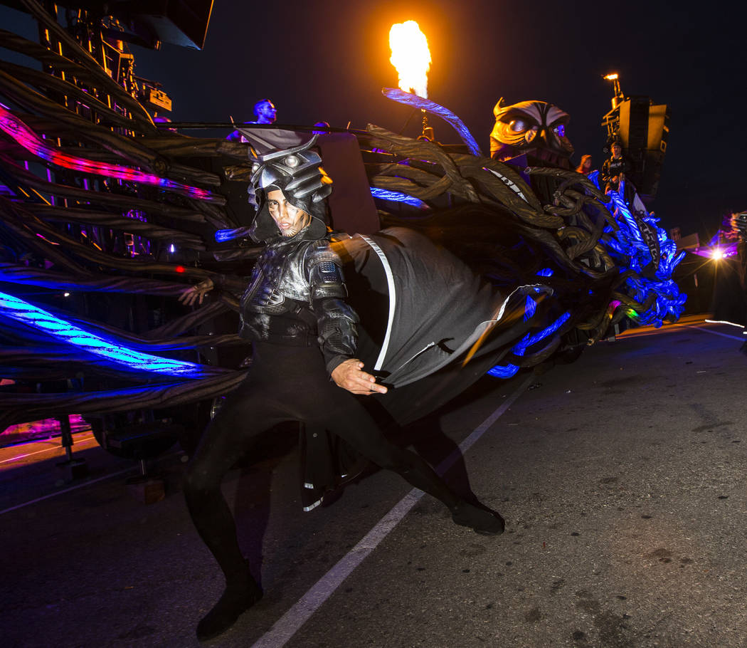 A costumed performer dances outside of the Parliament art car during the second day of the Elec ...