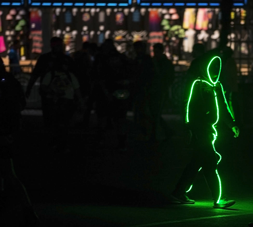A neon shadow makes his way to the Cosmic Meadow stage during day two of Electric Daisy Carniva ...