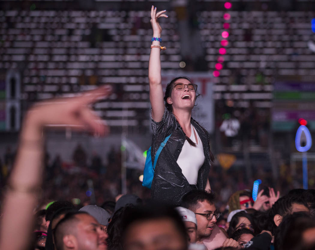 Fans cheer for A$AP Rocky during his performance on the Cosmic Meadow stage during day two of E ...