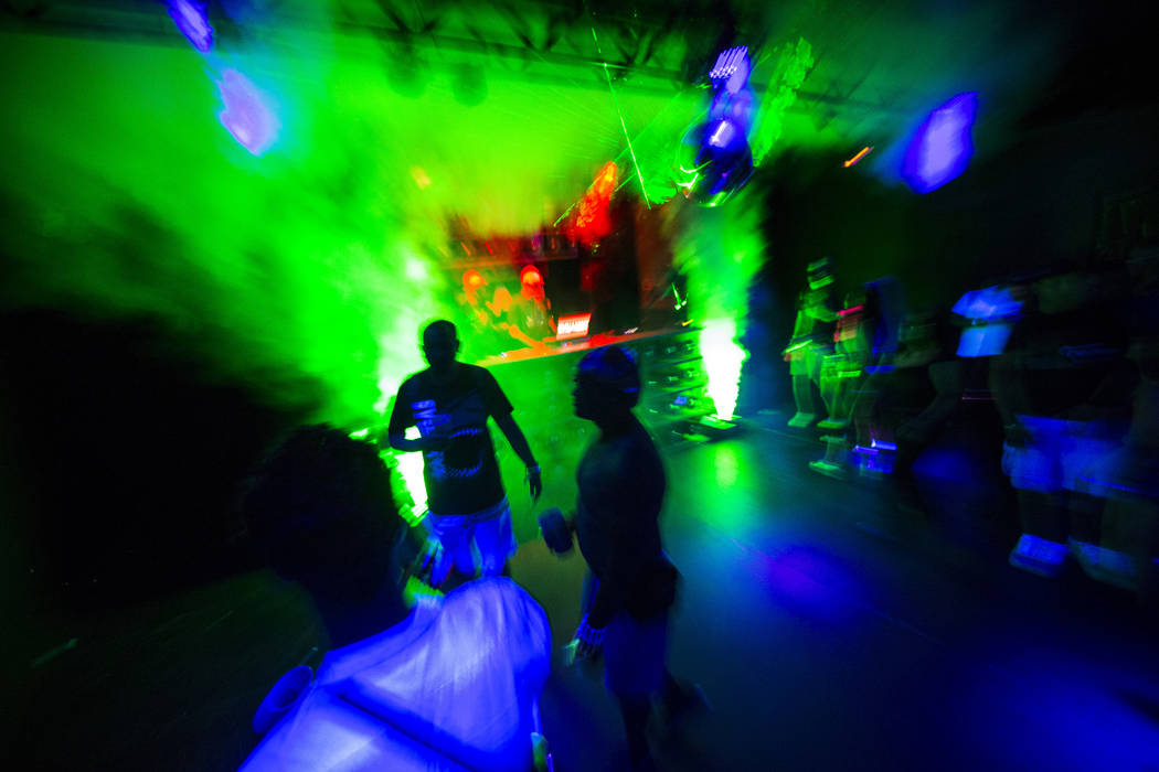 Attendees dance at the Headlight in Downtown EDC during the second day of the Electric Daisy Ca ...