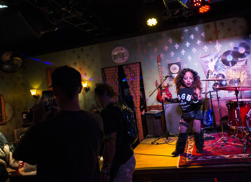 A performer dances at the punk-themed Mini Bar in Downtown EDC during the second day of the Ele ...