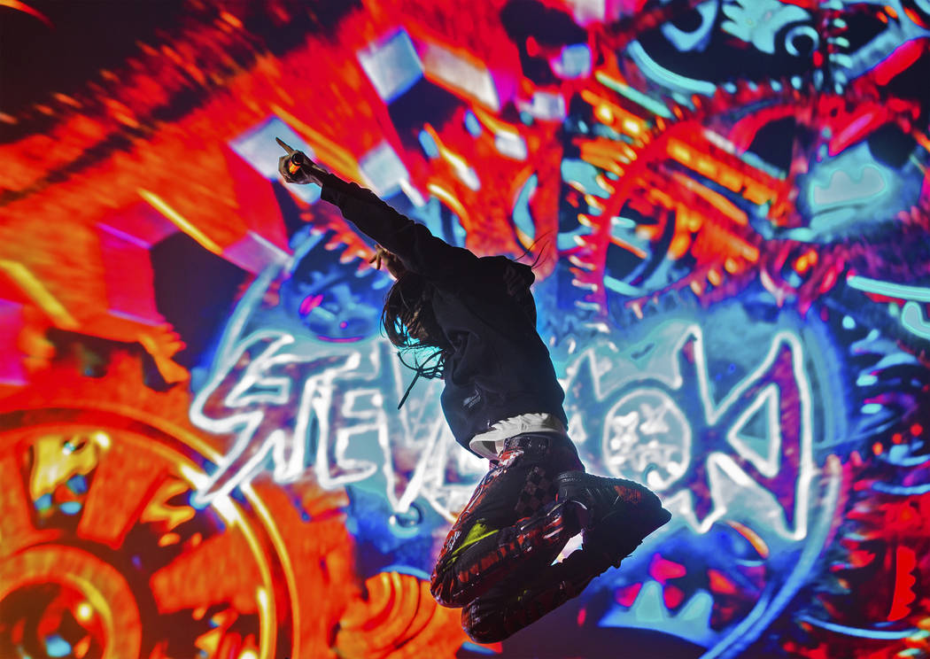 Steve Aoki leaps in the air during his performance at the Circuit Grounds stage on day three of ...