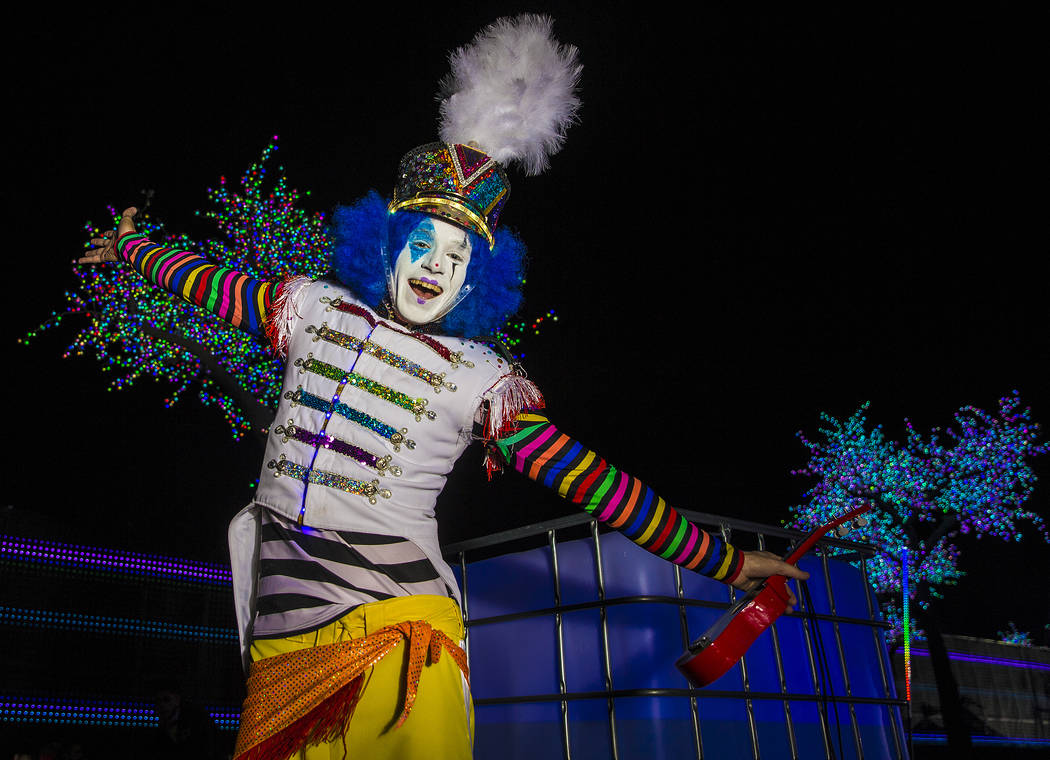 A member of the EDC Clown Marching Band dances outside Pixel Forest on day three of Electric Da ...