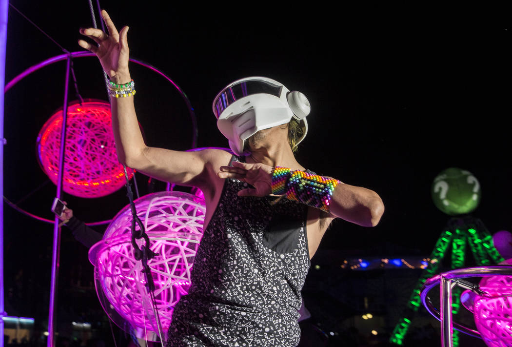 Sergio Gonzalez, from Los Angeles, Calif., dances outside the Cosmic Meadow stage on day three ...