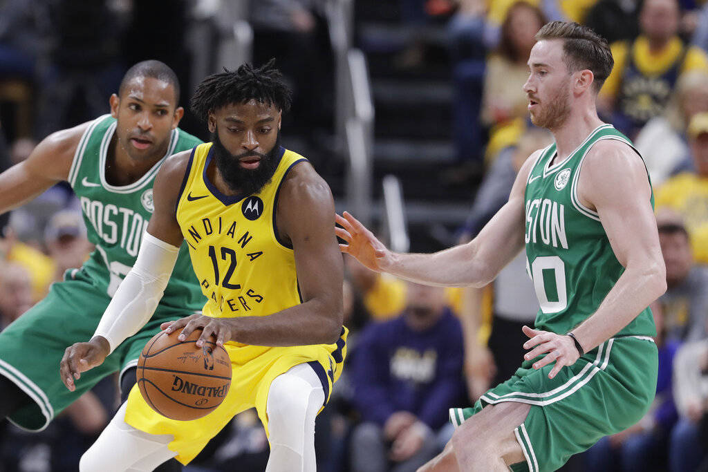 Indiana Pacers' Tyreke Evans (12) is defended by Boston Celtics' Gordon Hayward (20) during the ...