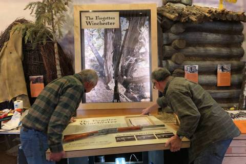 "Workers from design company DiVittorio and Associates help install the new ""Forgotten Winchest ..."