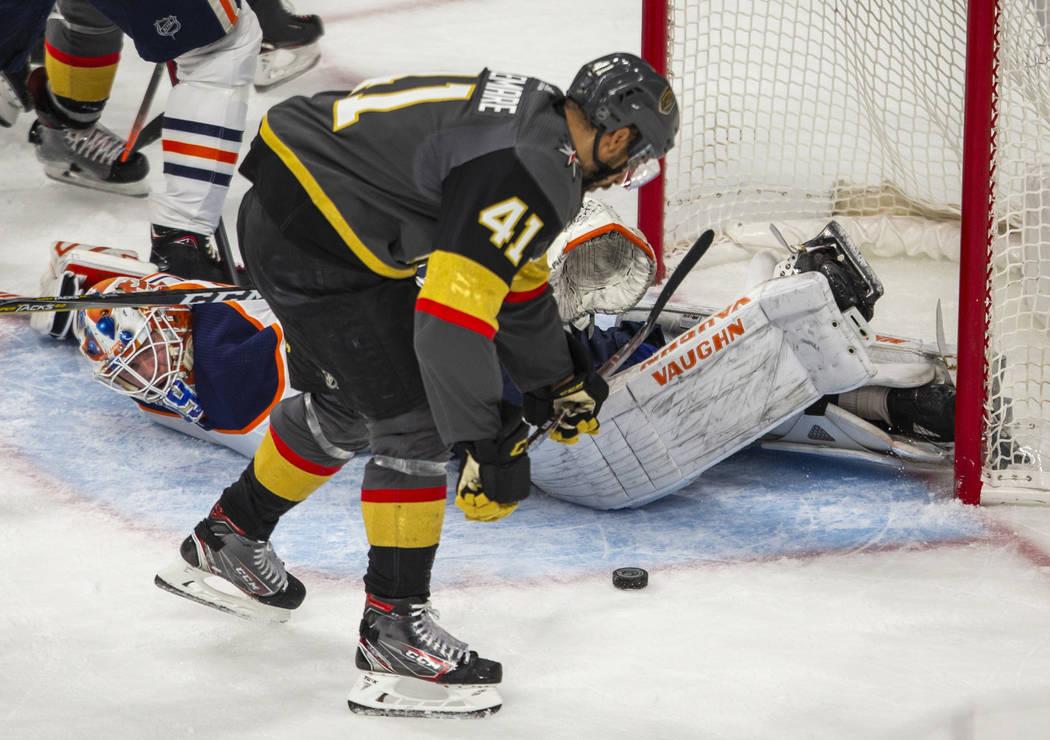 Edmonton Oilers goaltender Mikko Koskinen (19) is down on the ice as Vegas Golden Knights cente ...