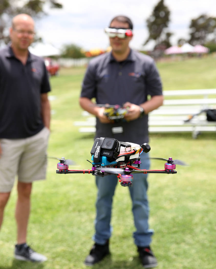 Shawn Capalingo, right, flies his custom built copia frame free style racing drone over Craig R ...