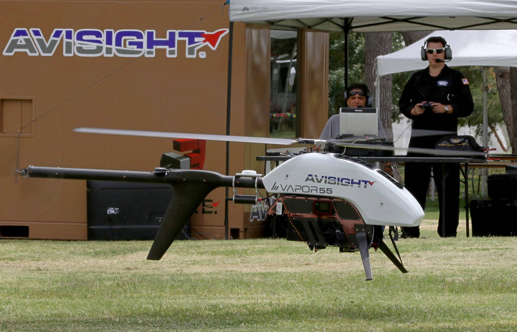 Jason Daub, a pilot in command, flies the Vapor 55 unmanned helicopter over Craig Ranch Park on ...