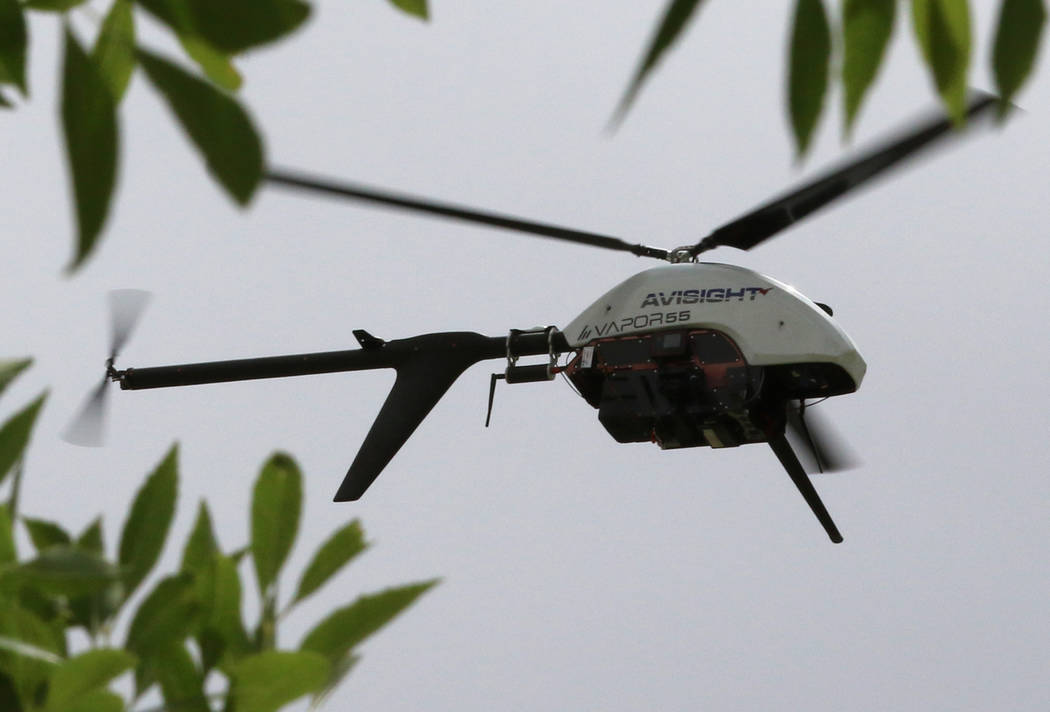 The Vapor 55 unmanned helicopter flies over Craig Ranch Park on Friday, May 17, 2019, as drone ...