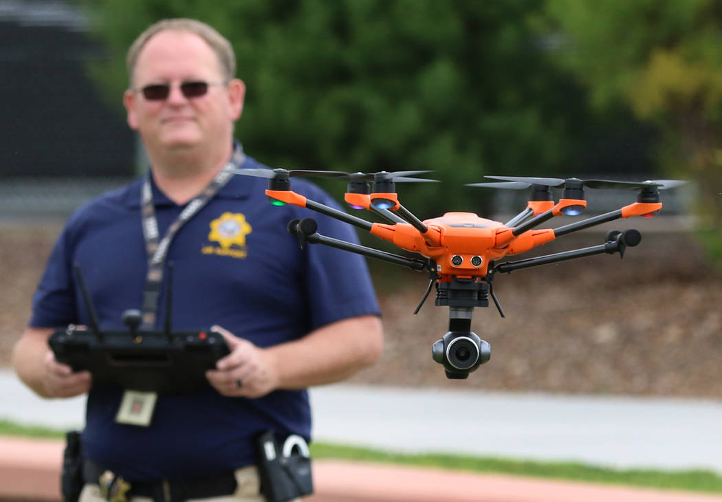 Dave Martel, Metro's small unmanned aerial system program manager, flies his drone over Craig ...