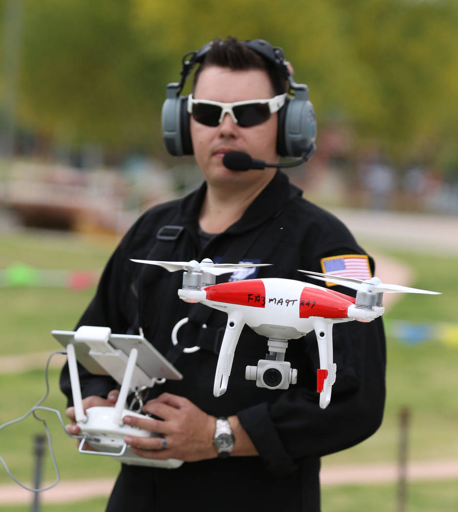Jason Daub, a pilot in command, flies his Phantom IV drone over Craig Ranch Park on Friday, May ...