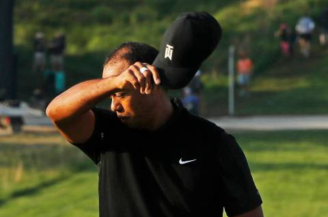 Tiger Woods removes his hat after finishing the second round of the PGA Championship golf tourn ...