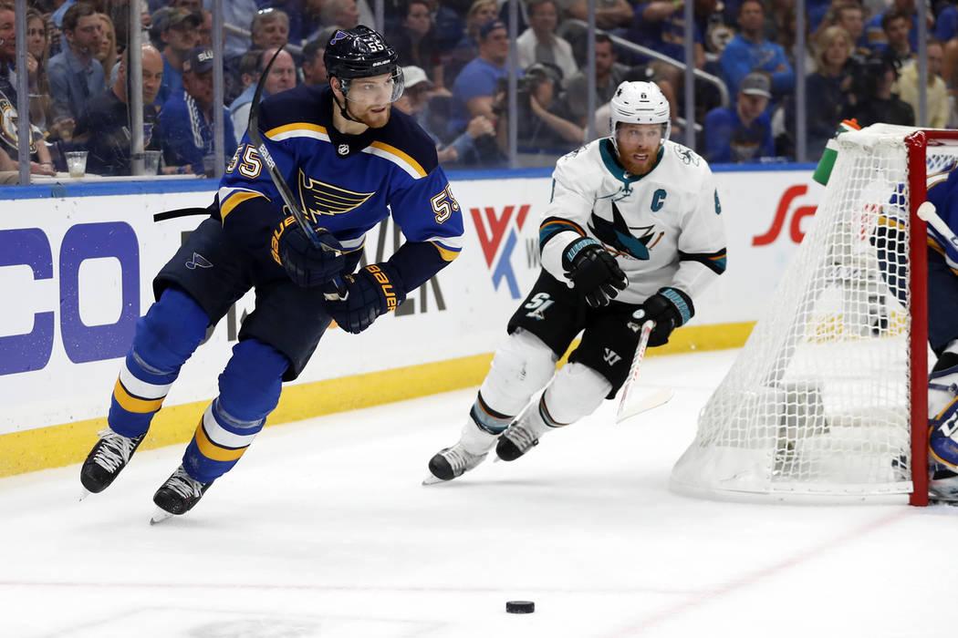 St. Louis Blues defenseman Colton Parayko (55) and San Jose Sharks center Joe Pavelski (8) chas ...
