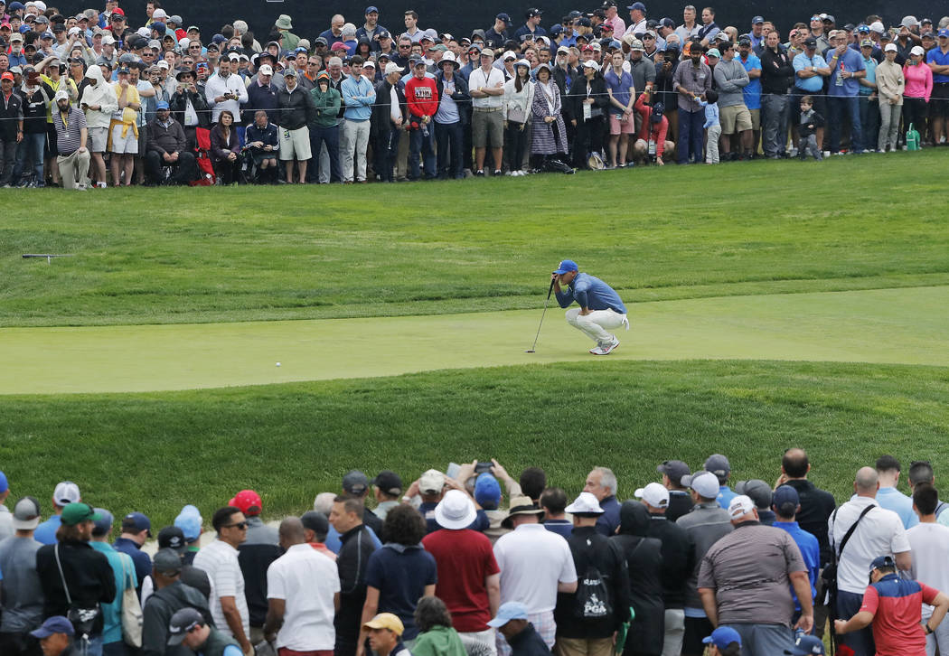 Brooks Koepka lines up a putt on the first green during the second round of the PGA Championshi ...