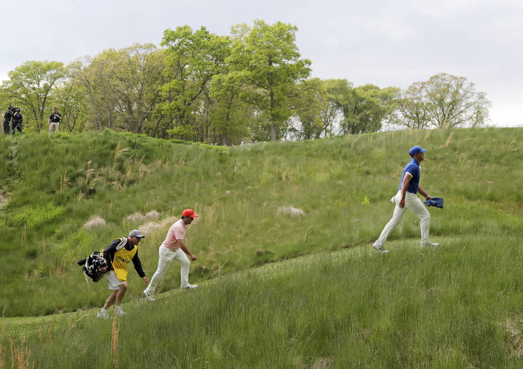 Brooks Koepka walks to the ninth tee during the second round of the PGA Championship golf tourn ...