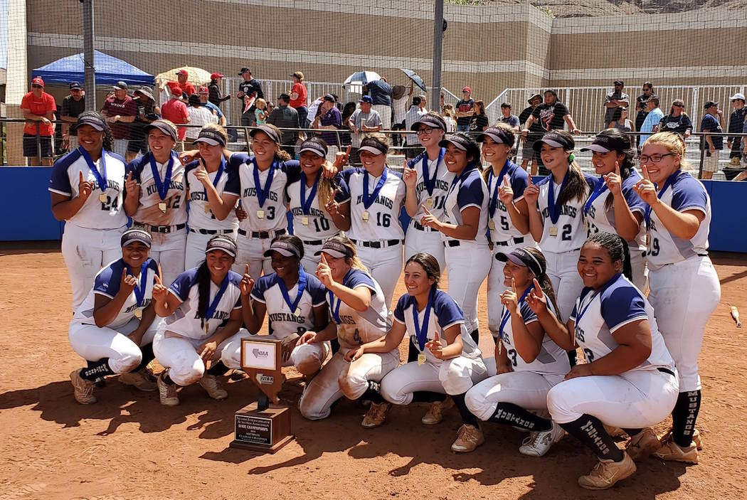 Shadow Ridge players pose for a team photo after defeating Coronado, 13-3 in the Class 4A state ...