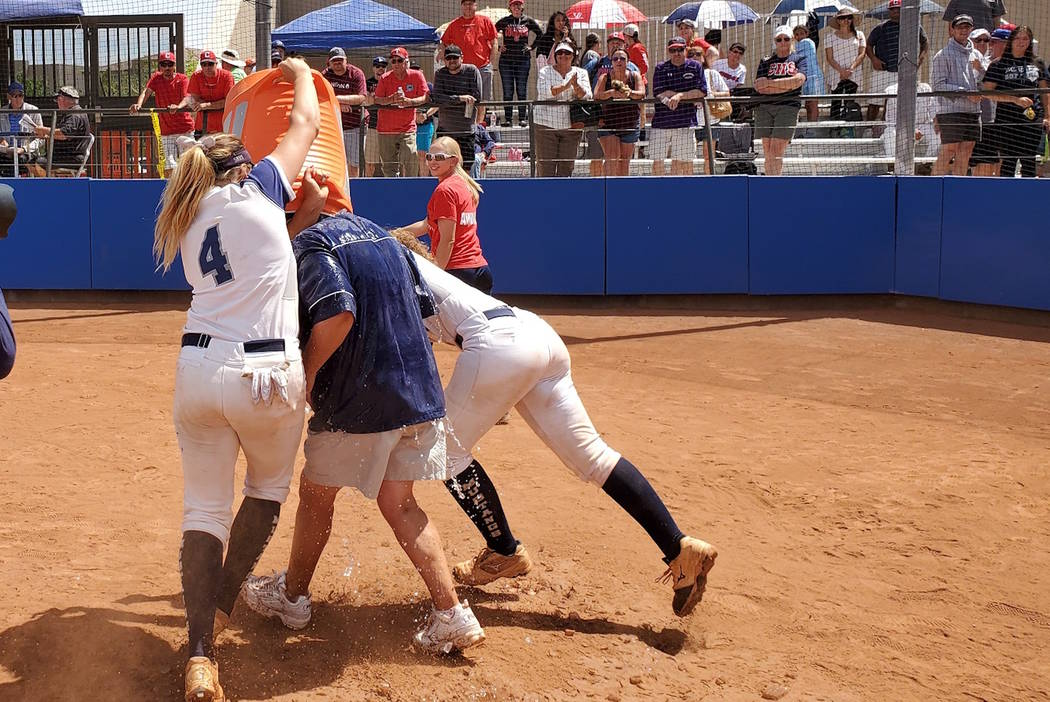 Shadow Ridge's Shea Clements (4) and Caitlin Covington celebrate by dousing coach Julia Meyn af ...