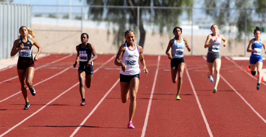 Kennedy Brace Centennial, third from left, on her way to winning the 400 meters in the state tr ...