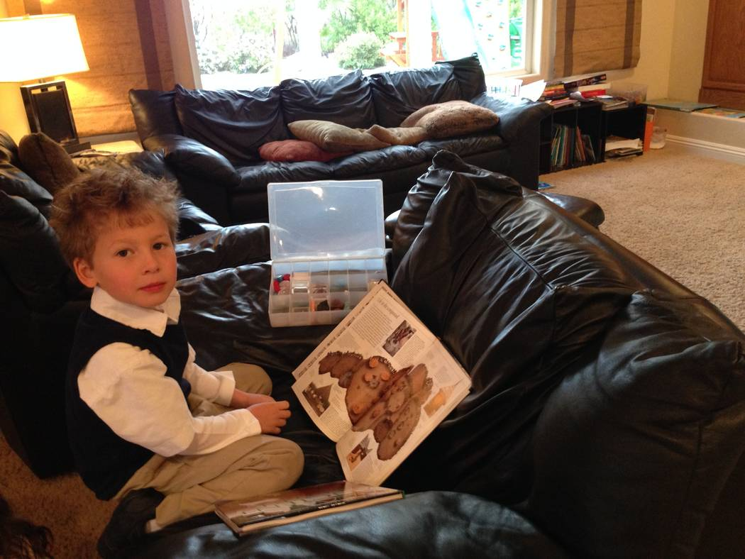 Jack Stark at 5 studying an atlas his mom gave him. (Courtesy)