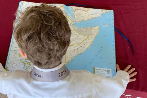 Jack Stark studies an atlas at Challenger School-Summerlin on May 15. (Mia Sims, Las Vegas Revi ...
