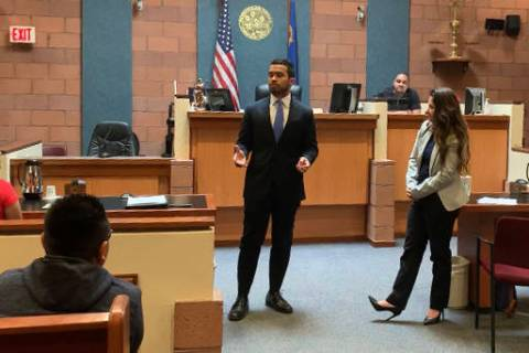 Julio Garcia, left, and Jen Smith, both graduating students at Boyd Law School at UNLV, speak ...
