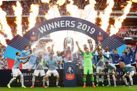 Manchester City players celebrate after winning the English FA Cup Final soccer match between M ...