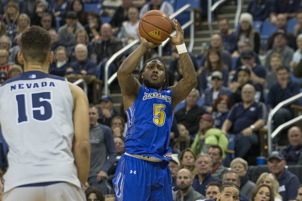 South Dakota State guard David Jenkins (5) shoots against Nevada in the second half of an NCAA ...