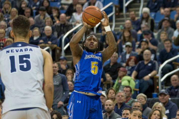 South Dakota State guard David Jenkins shoots against Nevada in the second half of an NCAA coll ...