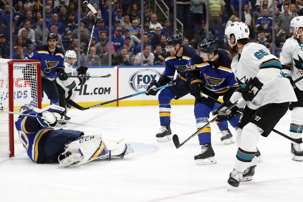 San Jose Sharks defenseman Erik Karlsson (65), of Sweden, scores the winning goal past St. Loui ...