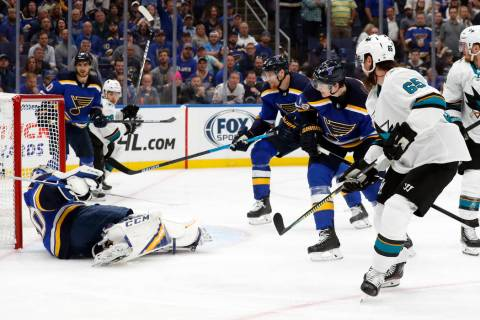 San Jose Sharks defenseman Erik Karlsson (65), of Sweden, scores the winning goal past St. Loui ...