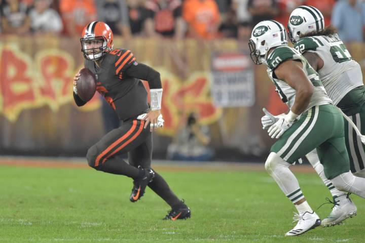 Cleveland Browns quarterback Baker Mayfield looks to pass during an NFL football game against t ...