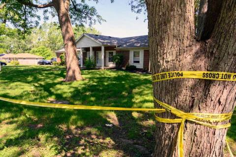 Police continue to investigate the scene of a shooting, Saturday, May 18, 2019 in Muncie, Ind. ...