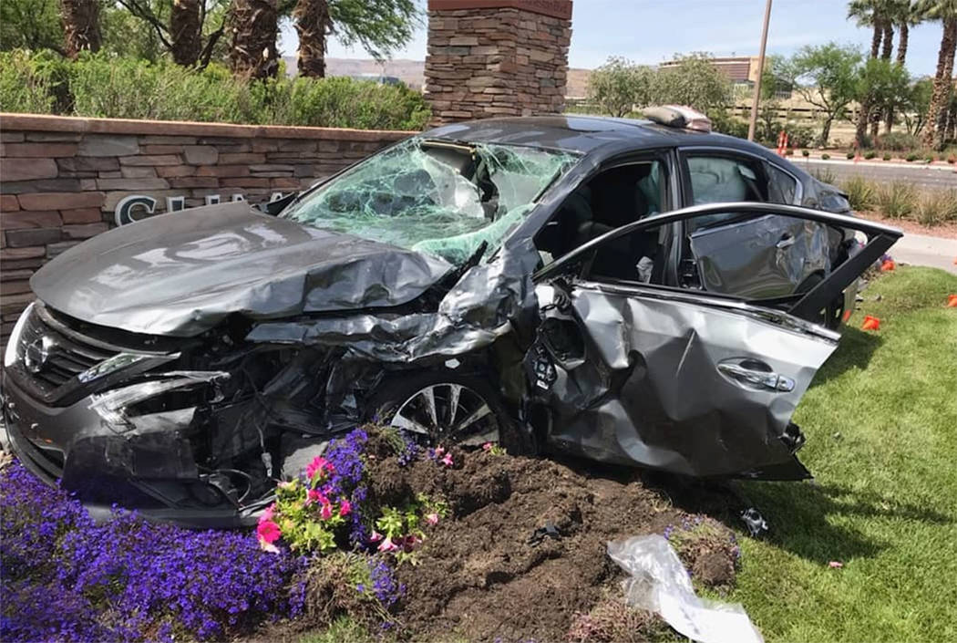 A car is seen at the site of a fatal crash at West Charleston Boulevard and South Town Center D ...