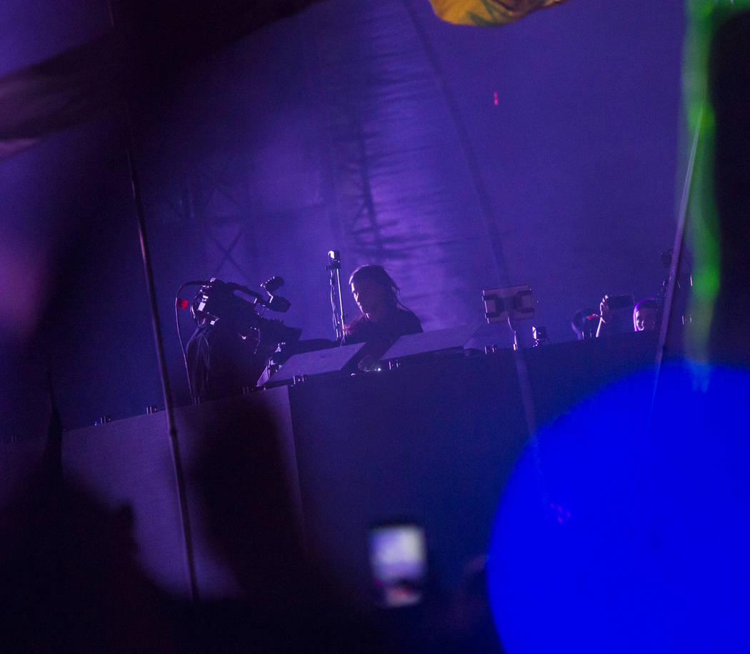 Skrillex performs during a surprise set at the Circuit Grounds stage during the second day of t ...