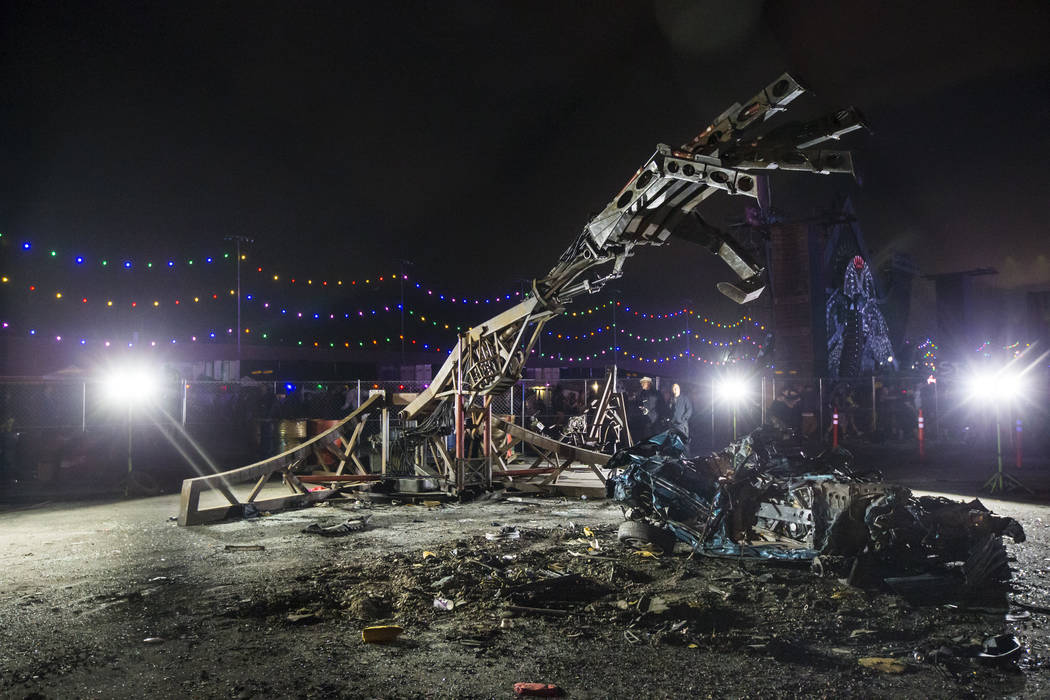 A smashed car is seen by The Hand of God during the second day of the Electric Daisy Carnival a ...